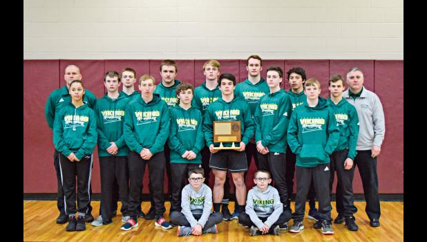 The varsity wrestling team from Grayling High School celebrates its eighth consecutive Lake Michigan Conference championship on Saturday at Charlevoix. (Photo courtesy of Heather Green)